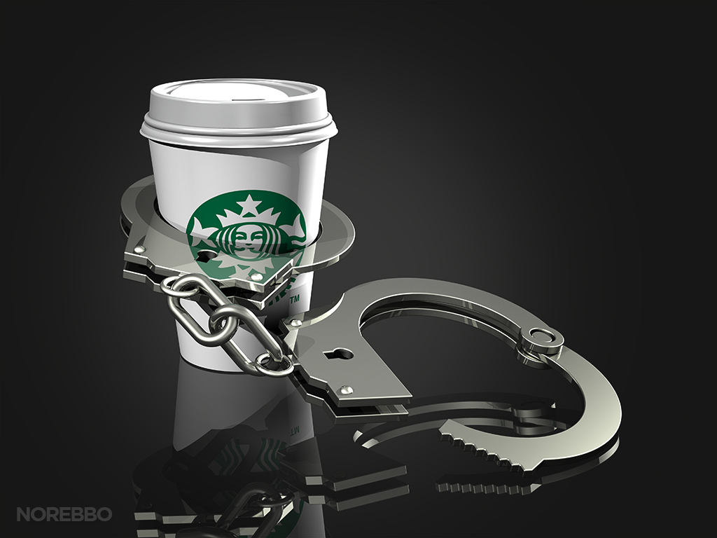handcuffs and starbucks coffee cup