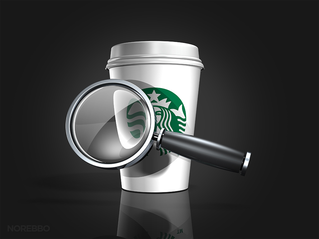 magnifying glass and starbucks coffee cup